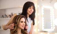 Women's Haircut and Style w/ Optional Partial or Full Highlights at Uniquely Gorgeous by Delicia (Up to 31% Off)