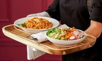 Four-Course Dinner for Two or Four with Bottles of Wine at La Dolce Vita Ristorante (Up to 50% Off)