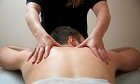 One or Two 60-Minute Massages at Romo Chiropractic (Up to 60% Off)