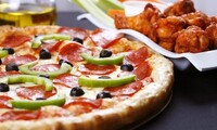 $12.50 for Two vouchers, Each Good for $12 Worth of Pizza at Dean's Pizza ($24 Total Value)
