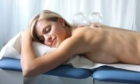 $32 for a Swedish Massage with Thai Yoga, Cupping, or Reflexology at Xscape Massage & Spa ($73 Value)