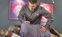 Chiropractic Consultation, Exam, and Two or Four Adjustments at The Joint Chiropractic (Up to 71% Off)