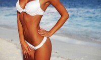 One or Three Airbrush Tanning Sessions with Debi Cross at Hair's Inn (Up to 51% Off)