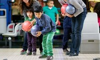 Early-Bird Unlimited-Play Package for Bowling and Lazer Tag for One or Four at Shenaniganz (Up to 55% Off)