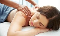 One-Hour Massage and Pain Consultation from New Health Centers (82% Off). Four Locations Available.