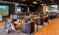 One or Two Hours of Virtual Golf with Beer, Well Drinks, or Soft Drinks at Clubhouse Golf Center (Up to 39% Off)