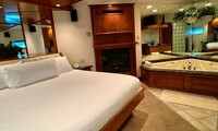 1-Night Stay for Two, with Sybaris Club Membership, in a Classic Whirlpool Suite at Sybaris - Downers Grove, IL
