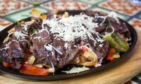 Lunch or Dinner at La Palmera (Up to 47% Off). Two Options Available.
