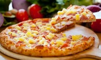 Food and Drinks at Gumba's Pizza (Up to 48% Off). Two Options Available.