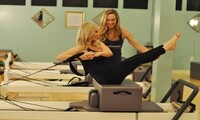 One Private Pilates Session with Optional Three Group Classes at Reforming Indy Pilates Studio (Up to 64% Off)